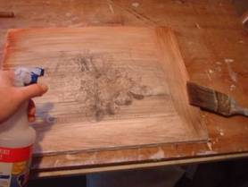toning the canvas with acrylic paint