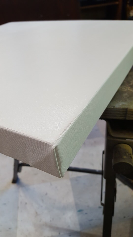 Perfectly folded canvas corners for gallery wrapped canvas.