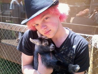 cody with baby goat reference photo